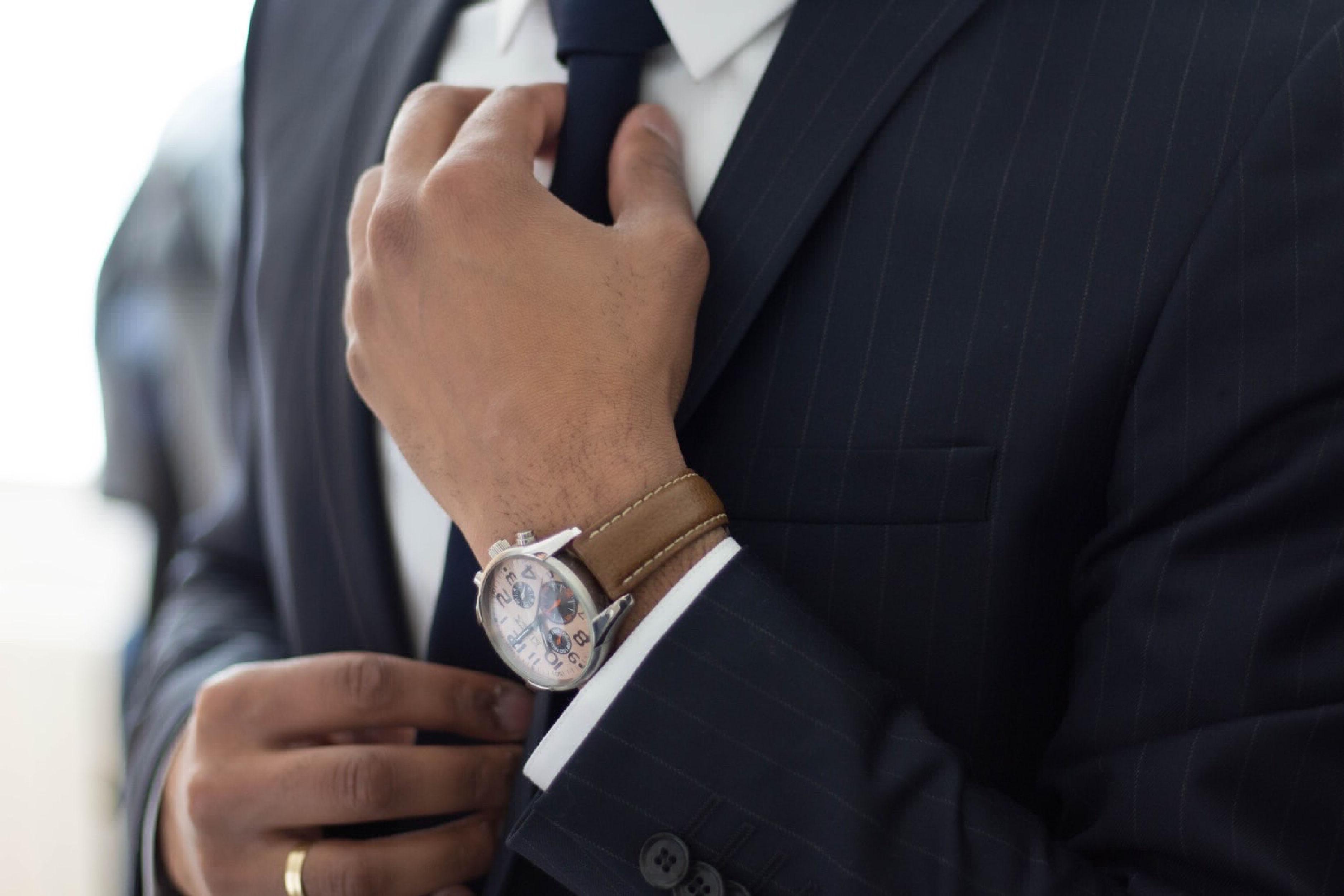 adjusting the tie by Ruthson Zimmerman